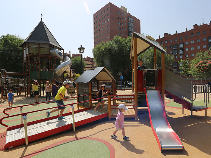 children playing on an inclusive playground multi-play unit featuring a ramp