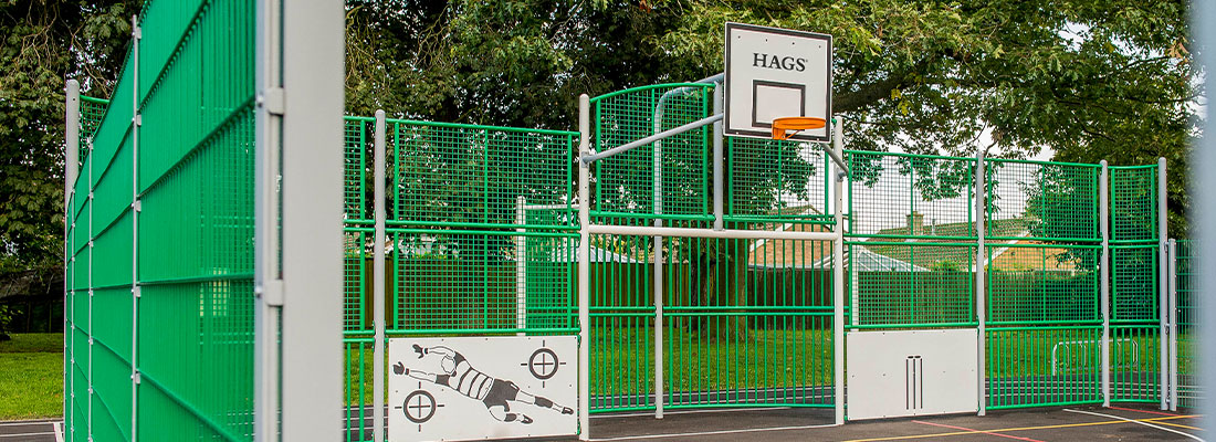 multi-sports court with basketball hoop and football goal