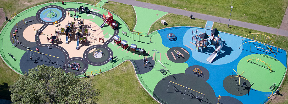 Playground with different colours of surfacing on each play area for easy navigation
